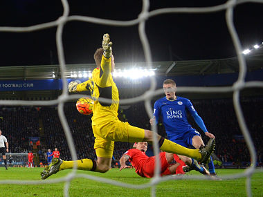 Jamie Vardy (R) of Leicester City scores his team's second goal past Simon Mignolet (L) of Liverpool. Getty