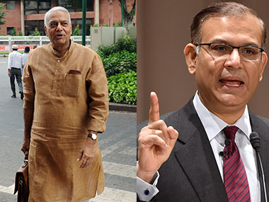 Yashwant Sinha and (R) Minister of State for Finance Jayant Sinha.