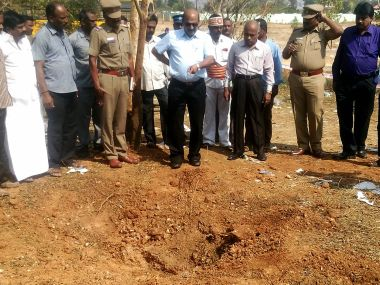 Authorities inspect the site where the alleged meteorite landed in Vellore. AFP
