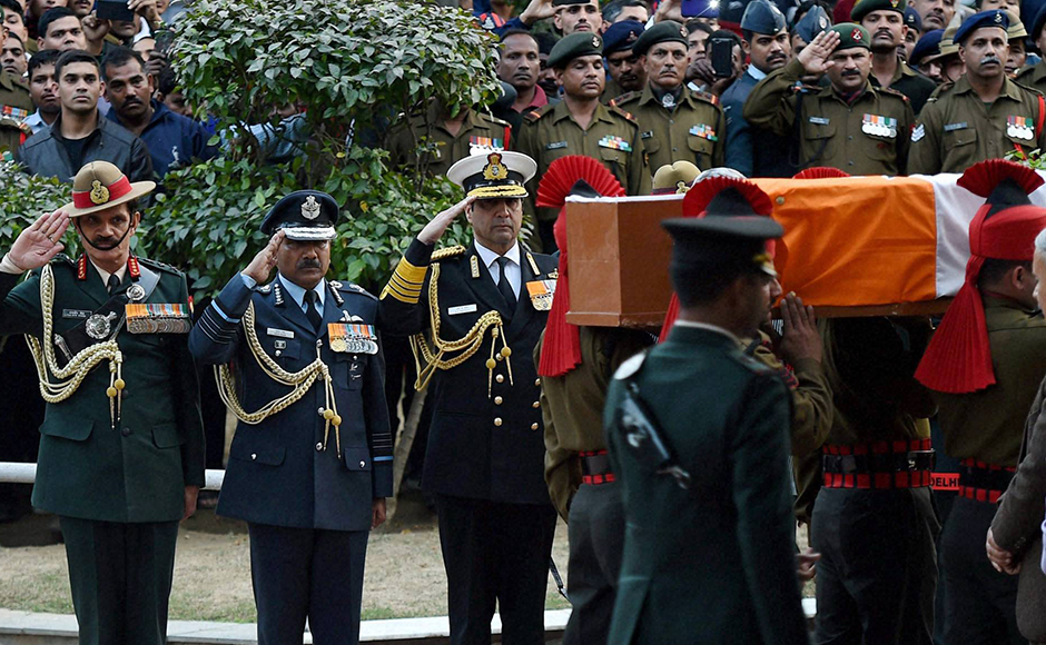 Army chief Gen. Dalbir Singh Suhag, Air Chief Marshal Arup Raha and Navy Cheif, Admiral Robin K. Dhowan pay last respect to Lance Naik Hanumanthappa Koppad in Brar square, New Delhi on Thursday. Koppad was miraculously found alive after remaining buried under huge mass of snow for six days at Siachen Glacier, died in New Delhi on Thursday. PTI Photo by Manvender Vashist
