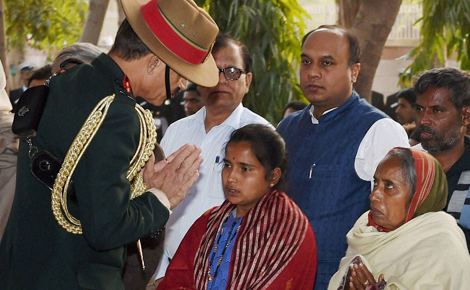 Army chief Gen. Dalbir Singh Suhag with Lance Naik Hanumanthappa Koppad's family members at Brar square in New Delhi on Thursday. Koppad was miraculously found alive after remaining buried under huge mass of snow for six days at Siachen Glacier, died in New Delhi on Thursday. PTI Photo by Manvender Vashist