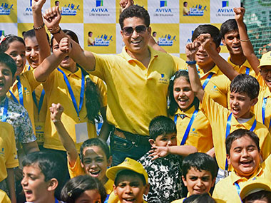 Sachin Tendulkar with kids during a promotional event in Mumbai on Friday. PTI
