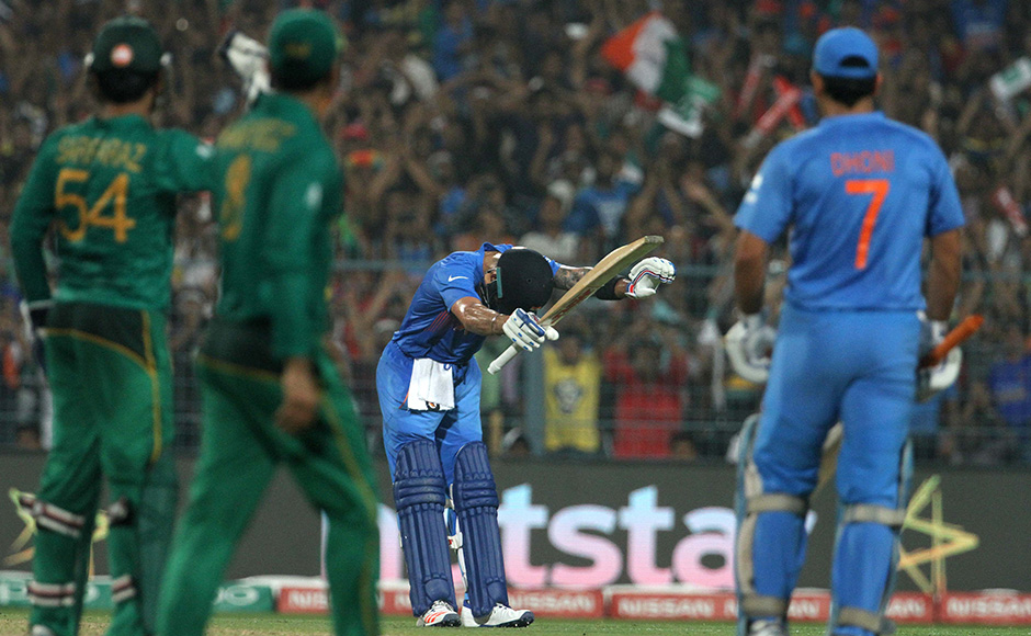 Virat Kohli played a masterful knock of 55 as India continued their dominance over Pakistan with a six wicket win at the Eden Gardens.  (In Picture) - Virat Kohli bows down to Sachin Tendulkar in the stands after scoring after reaching his half-century. Solaris