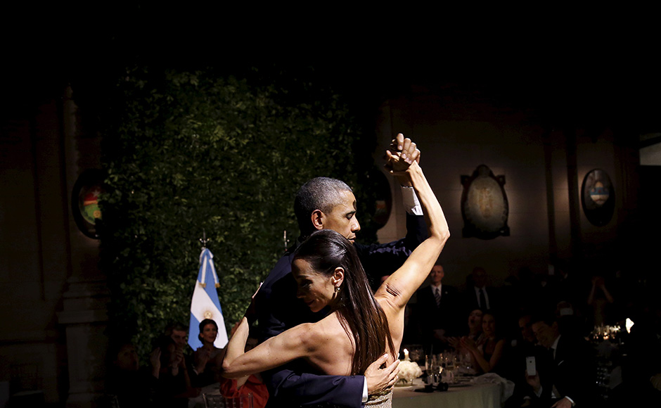 U.S. President Barack Obama dances tango during a state dinner hosted by Argentina's President Mauricio Macri at the Centro Cultural Kirchner as part of President Obama's two-day visit to Argentina, in Buenos Aires March 23, 2016. REUTERS/Carlos Barria TPX IMAGES OF THE DAY - RTSBZI1