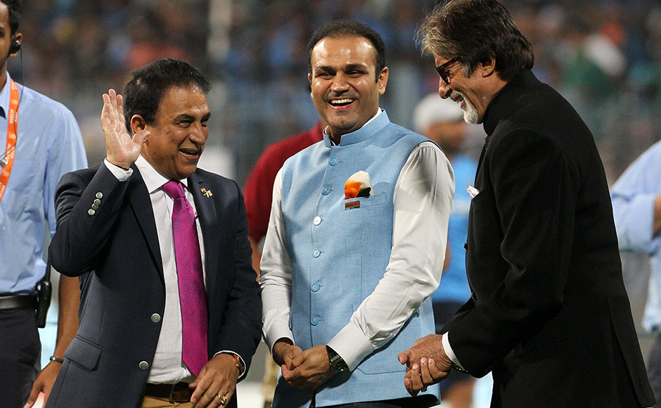 Former India captain Sunil Gavaskar and cricketer Virender Sehwag share a joke with Bollywood actor Amitabh Bachchan before the start of the match. Solaris