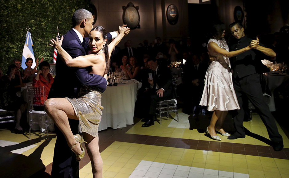 U.S. President Barack Obama and his wife Michelle dance tango during a state dinner hosted by Argentina's President Mauricio Macri at the Centro Cultural Kirchner as part of President Obama's two-day visit to Argentina, in Buenos Aires March 23, 2016. REUTERS/Carlos Barria TPX IMAGES OF THE DAY - RTSBZI2