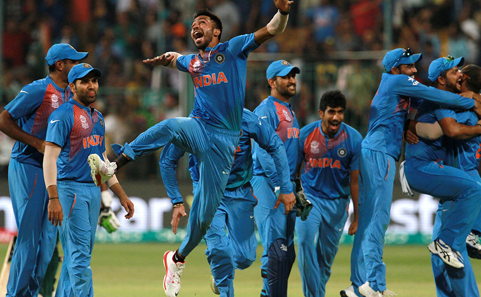 Indian players celebrate after winning the ICC Twenty20 World Cup match played between India and Bangladesh at the M Chinnaswamy Stadium in Bengaluru, India on March 23, 2016. (Vipin Pawar/SOLARIS IMAGES)