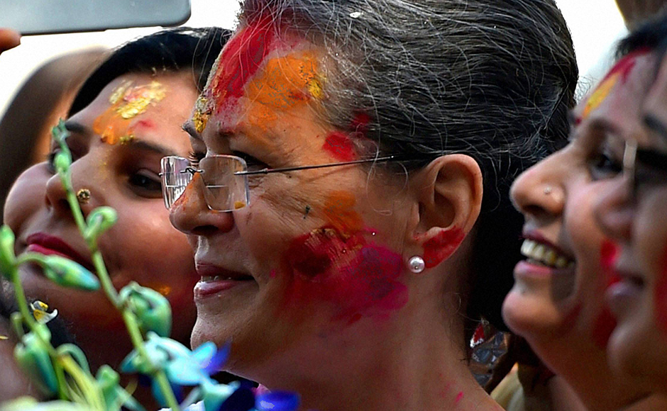 Congress President Sonia Gandhi celebrate Holi with party workers at All India Congress Committee headquarters (AICC) in New Delhi on Thursday. PTI Photo