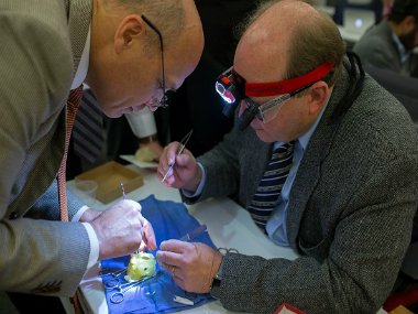 The Hospital for Sick Children head of cardiovascular surgery Glen Arsdell, left, works with Pediatric Cardiac Surgeon on a 3D printed heart in Toronto in January. GETTY IMAGES