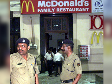 File photo of policemen standing guard after a blast outside a McDonalds restaurant on 6 December, 2002.  Reuters