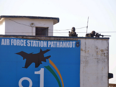 Indian commandos overlook the air force base in Pathankot on 5 January,2016. Getty Images