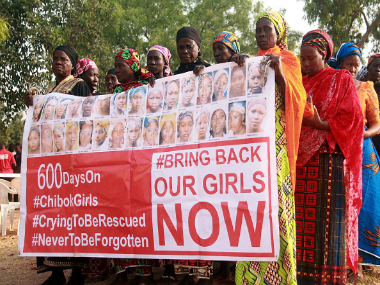 Members of the 'Bring Back Our Girls' movement during a rally in Abuja on 14 January 2016. Getty Images