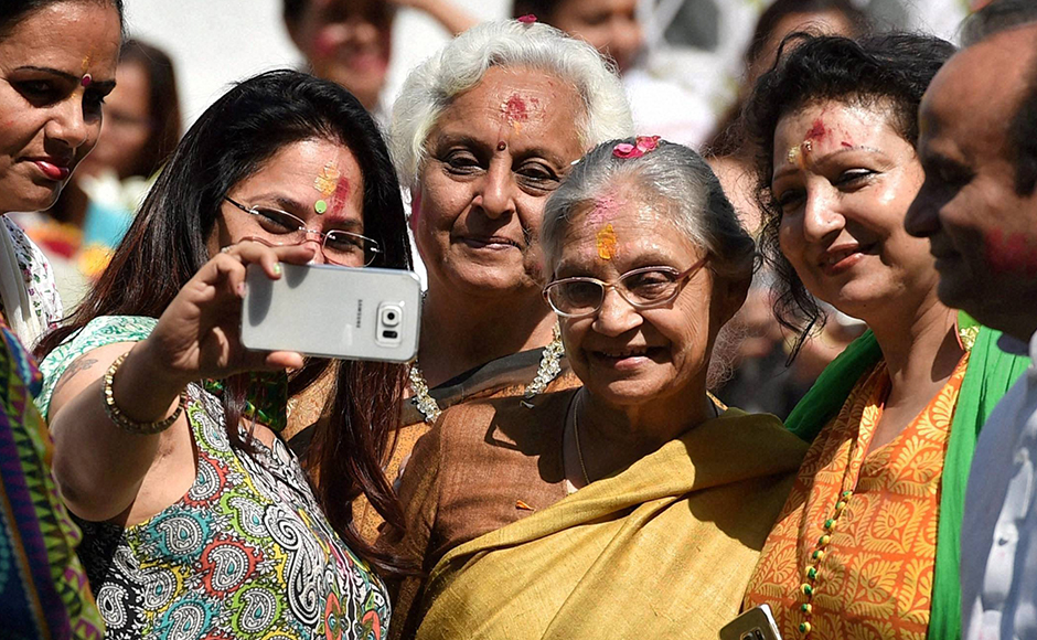 Former Delhi chief minister Sheila Dikshit with party workers during the Holi celebrations at All India Congress Committee headquarters (AICC) in New Delhi on Thursday. PTI Photo