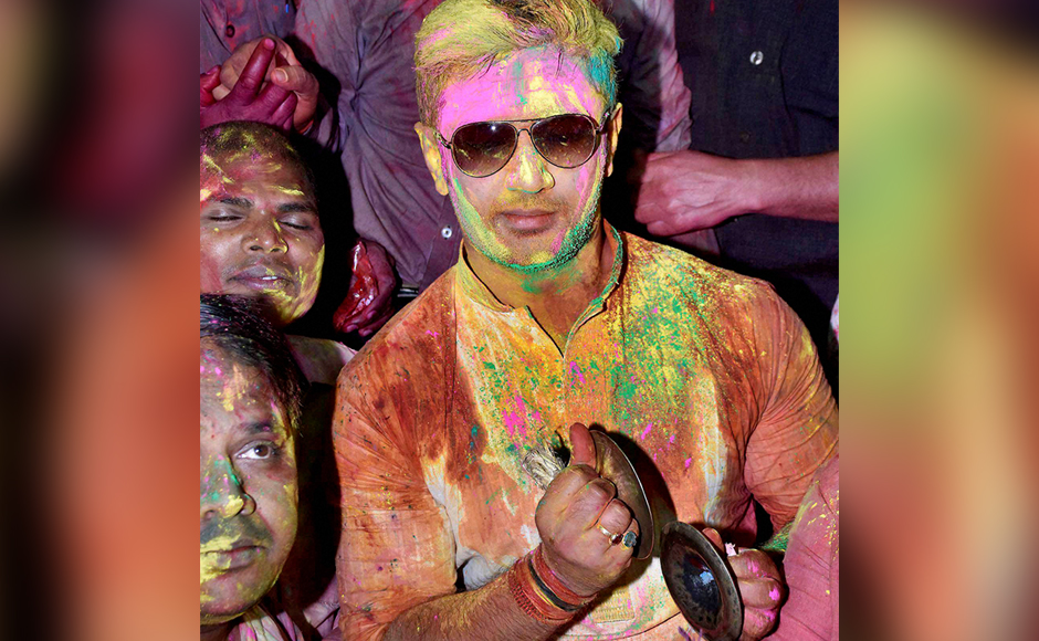 LJP MP Chirag Paswan celebrates Holi with his party workers in Patna on Tuesday. PTI Photo