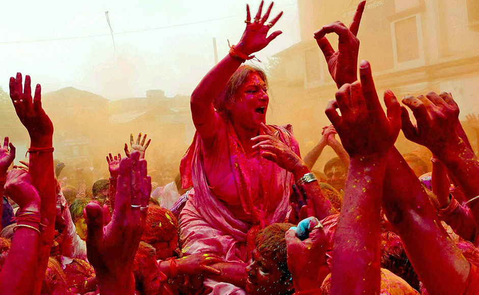 BJP candidate of Howrah North Constituency Rupa Ganguly celebrate Holi with party workers during her election campaign at Howrah district of West Bengal on Thursday ahead of upcoming State Assembly election. PTI Photo