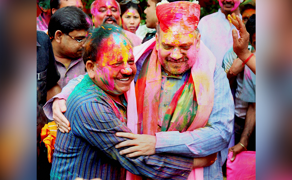 BJP National President Amit Shah and Minister for Science and Technology and Earth Sciences Harsh Vardhan during Holi celebrations in New Delhi on Thursday. PTI Photo