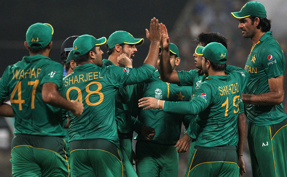 Pakistan players celebrates the wicket of Indian player Shikhar Dhawan during the ICC Twenty20 World Cup match played between Indian and Pakistan at the Eden Garden Stadium in Kolkata, India on March 19, 2016. Getty Images
