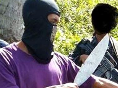 Undated photo distributed by the private terrorism monitor SITE Intelligence Group on September 23, 2014 is reported to show militants with the Philippines-based Abu Sayyaf group. AFP