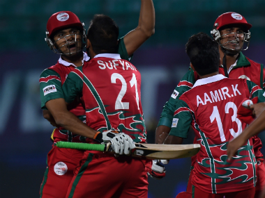 Ajay Lalcheta and Oman team-mates celebrate win over Ireland. AFP