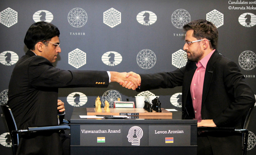 Viswanathan Anand (left) after his 66-move win against Levon Aronian of Armenia at the Central Telegraph Building in Moscow on Monday. Amruta Mokal