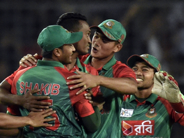 Bangladesh players celebrate the fall of Rohit Sharma's wicket in Mirpur on Sunday. AFP