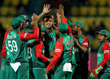 Bangladesh celebrate their win over Oman. AFP