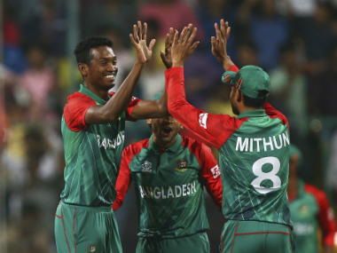 Bangladesh players celebrate the fall of an Australian wicket during their Group 2 encounter in Bengaluru. Getty Images