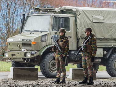 Belgian Army soldiers patrol Zaventem Airport in Brussels on Wednesday. AP