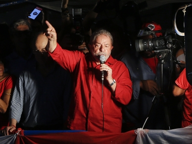 Brazil's former President Luiz Inacio Lula da Silva speaks during a rally in support of him and Brazil's President Dilma Rousseff, in Sao Paulo. AP