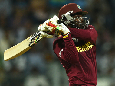 Chris Gayle hits one to the fence during his 48-ball 100 against England at the Wankhede on Wednesday. AFP