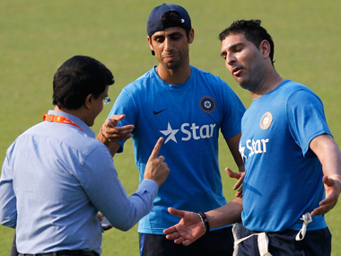 Former India captain Sourav Ganguly consults with Ashish Nehra and Yuvraj Singh at the Eden on Sunday ahead of their World T20 clash against Pakistan. AP