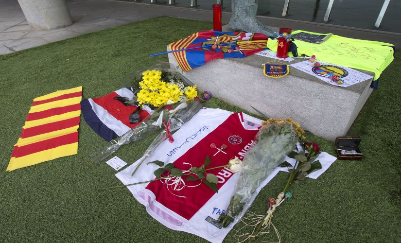 """FC Barcelona football club fan memorabilia is displayed in honor to the late Dutch soccer great Johan Cruyff at the Camp Nou stadium in Barcelona, Spain, Friday, March 25, 2016. Dutch soccer great Johan Cruyff, who revolutionized the game as the personification of """"Total Football,"""" died Thursday . He was 68. (AP Photo/Fernando Viros)"""