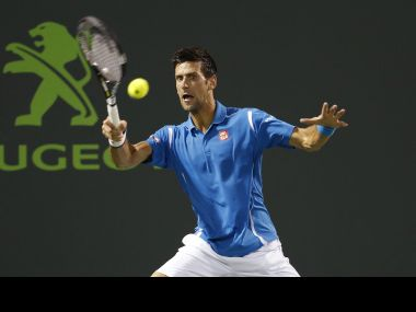 Novak Djokovic hits a forehand against Kyle Edmund. Reuters