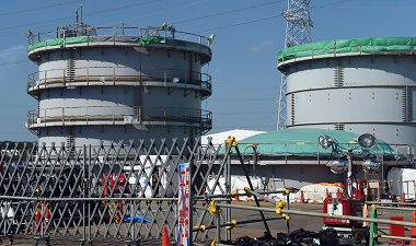 This picture shows the dismantling of flange tanks at the Fukushima Daiichi nuclear power plant in Okuma, Fukushima prefecture on October 9, 2015. Tokyo Electric Power Co (TEPCO), which operates the plant in eastern Japan, held a foreign press tour to the crippled Fukushima nuclear power plant on October 9 showing flange tanks dismantling the site, subdrain pit, relaying tanks, land-side and sea-side impermeable walls. AFP PHOTO / TOSHIFUMI KITAMURA