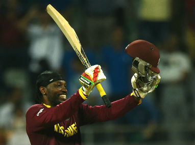 Chris Gayle celebrates his century at the Wankhede on Wednesday. AFP