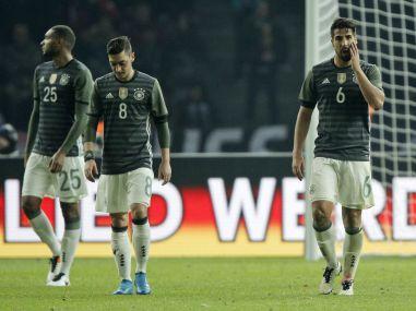 Germany's Jonathan Tah, Mesut Ozil and Sami Khedira after the loss to England. AP
