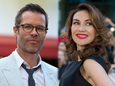 Guy Pearce with Carice Van Houten. Image from Reuters