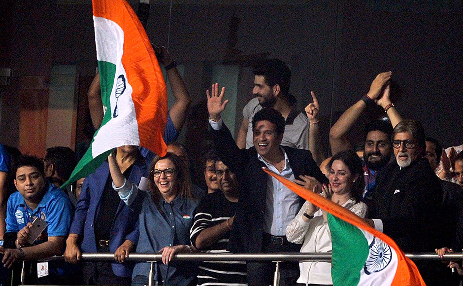 Mukesh Ambani, CMD, Reliance Industries Ltd, with wife Nita Ambani, Sachin Tendulkar and his wife Anjali Tendulkar, Bollywood actors Amitabh Bachchan and Abhishek Bachchan waving the tricolour after India's win over Pakistan. There was a huge star presence at the Eden Gardens and the Indian cricketers put on a show in front of them. Solaris