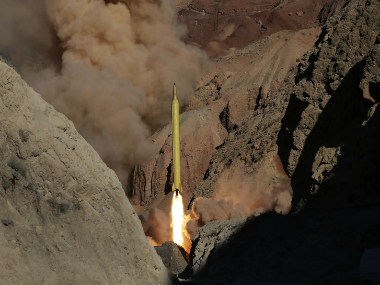 "Iran's powerful Revolutionary Guard test-fired two ballistic missiles Wednesday with the phrase ""Israel must be wiped out"" written on them, a show of deterrence power by the Islamic Republic as US Vice President Joe Biden visited Israel, Fars news agency reported. (AP Photo/Fars News Agency)"