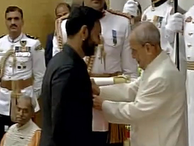 President Pranab Mukherjee confers the Padma Shri Award to actor Ajay Devgn. ANI