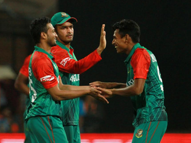 Bangladesh's Shakib Al Hasan celebrates with teammates after dismissing Australia's Mitchell Marsh at the M Chinnaswamy Stadium in Bengaluru on Monday. Solaris Images