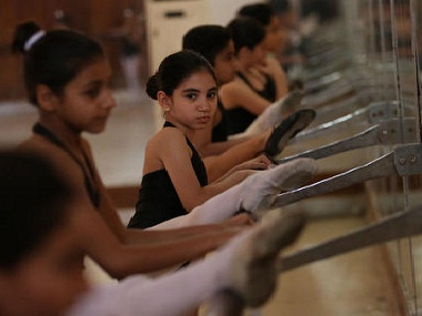 Students practise at the Baghdad School of Music and Ballet. AP