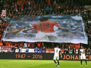 A banner of Johan Cruyff is seen as players observed a minute of silence in the 14th minute. AP