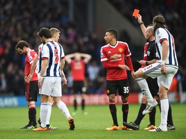Referee Mike Dean shows the red card to Juan Mata of Manchester United during their Barclays Premier League match against West Bromwich Albion. Getty