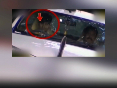 A video grab of Kerala IG's minor son driving an official car. CNN IBN