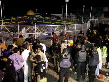 Police officers and rescue workers gather at the site of the bomb explosion. AP
