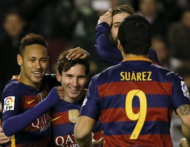Barcelona's Lionel Messi celebrates with team mates Luis Suarez and Neymar. Reuters
