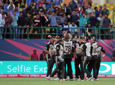 New Zealand players celebrate the fall of an Australian wicket at Dharamsala on Friday. Solaris Images