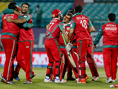 Oman players celebrate their two-wicket win over Ireland in Dharmsala on Wednesday. AP