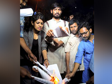 ABVP rebels burn a copy of the ancient text Manusmriti. Image from PTI
